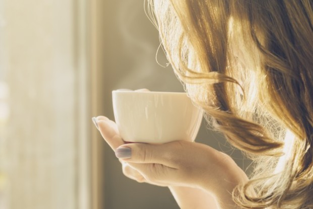 beautiful-girl-young-woman-drinks-coffee-alone-in-cafe_1220-1736